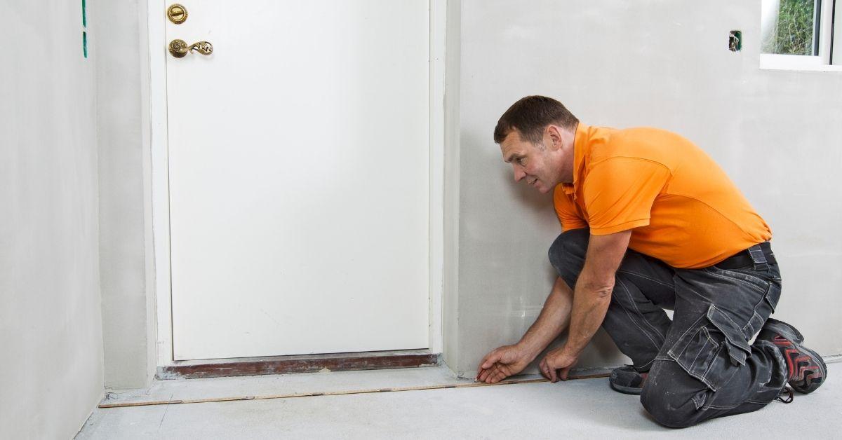 Man measuring a room