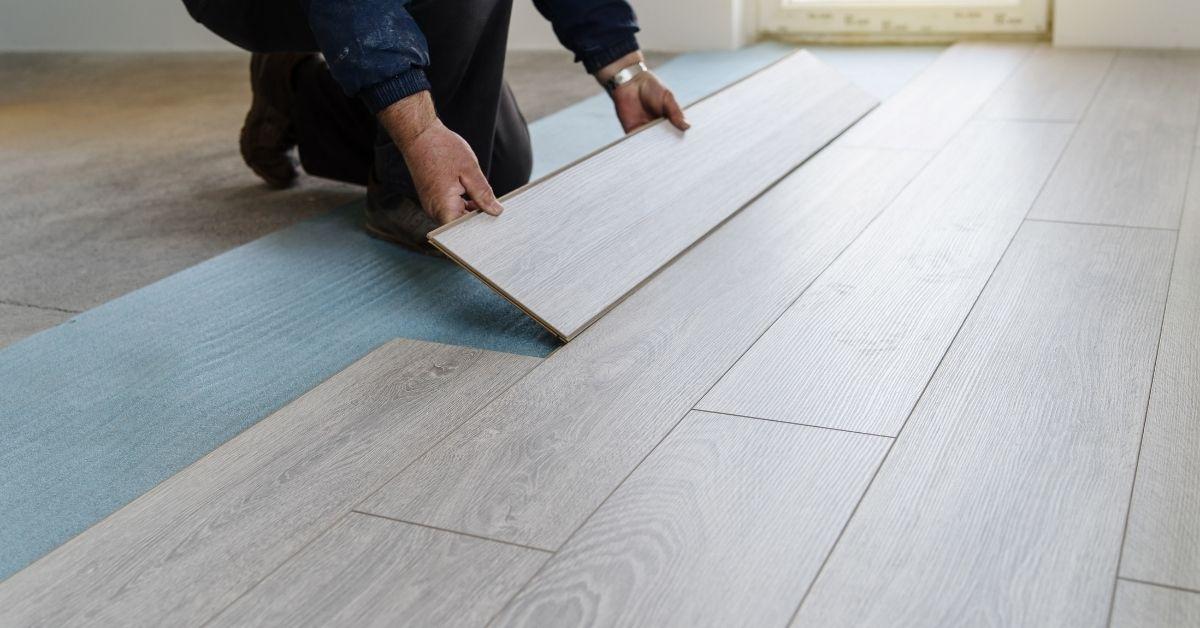 Someone fitting Laminate Flooring with Underlay